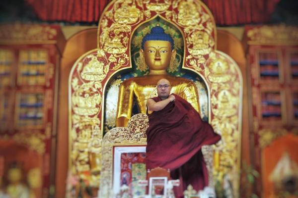 Karmapa in front of Buddha statue
