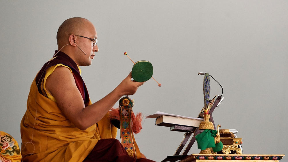 Karmapa playing the damaru drum