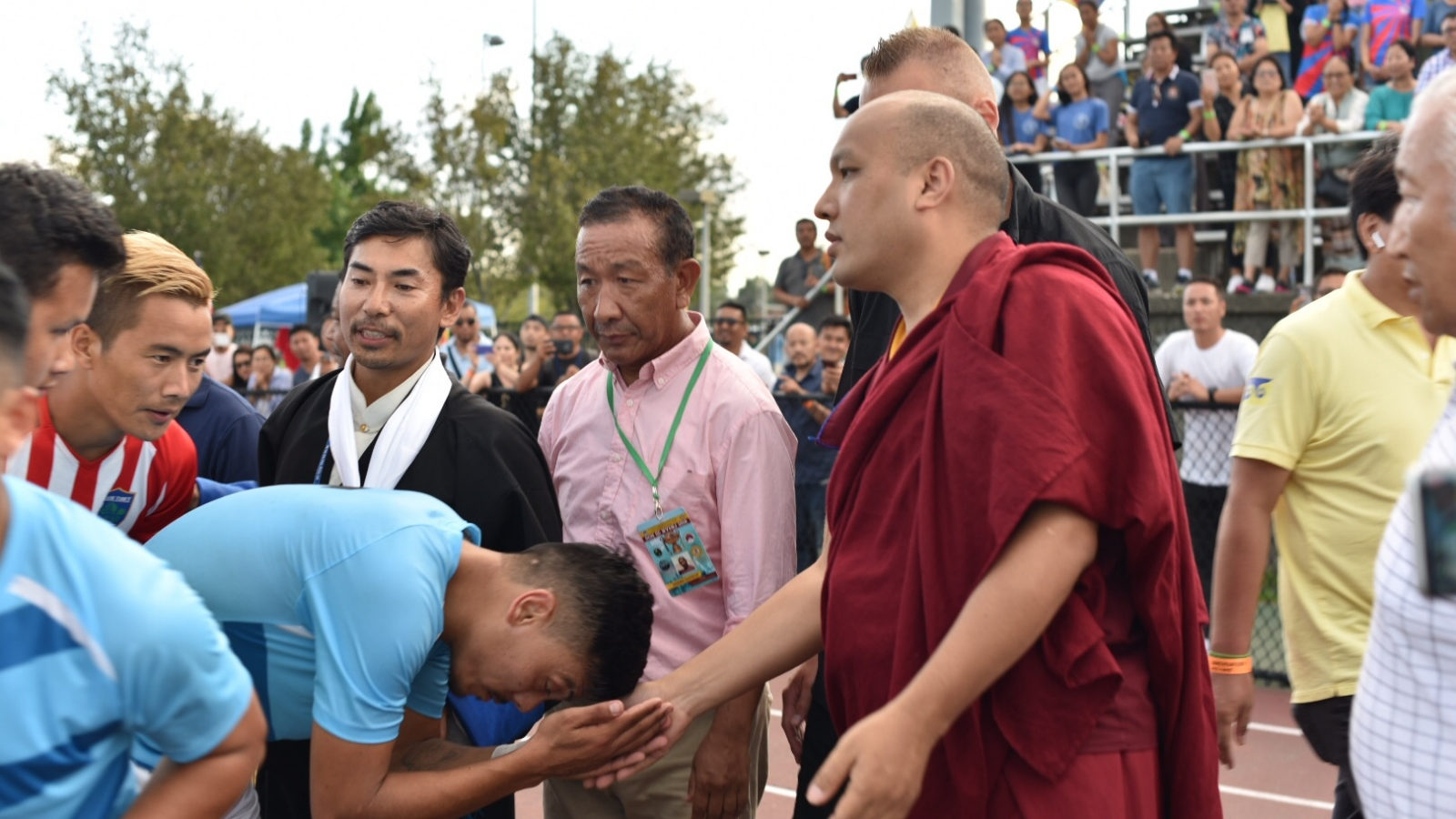 Karmapa watches football