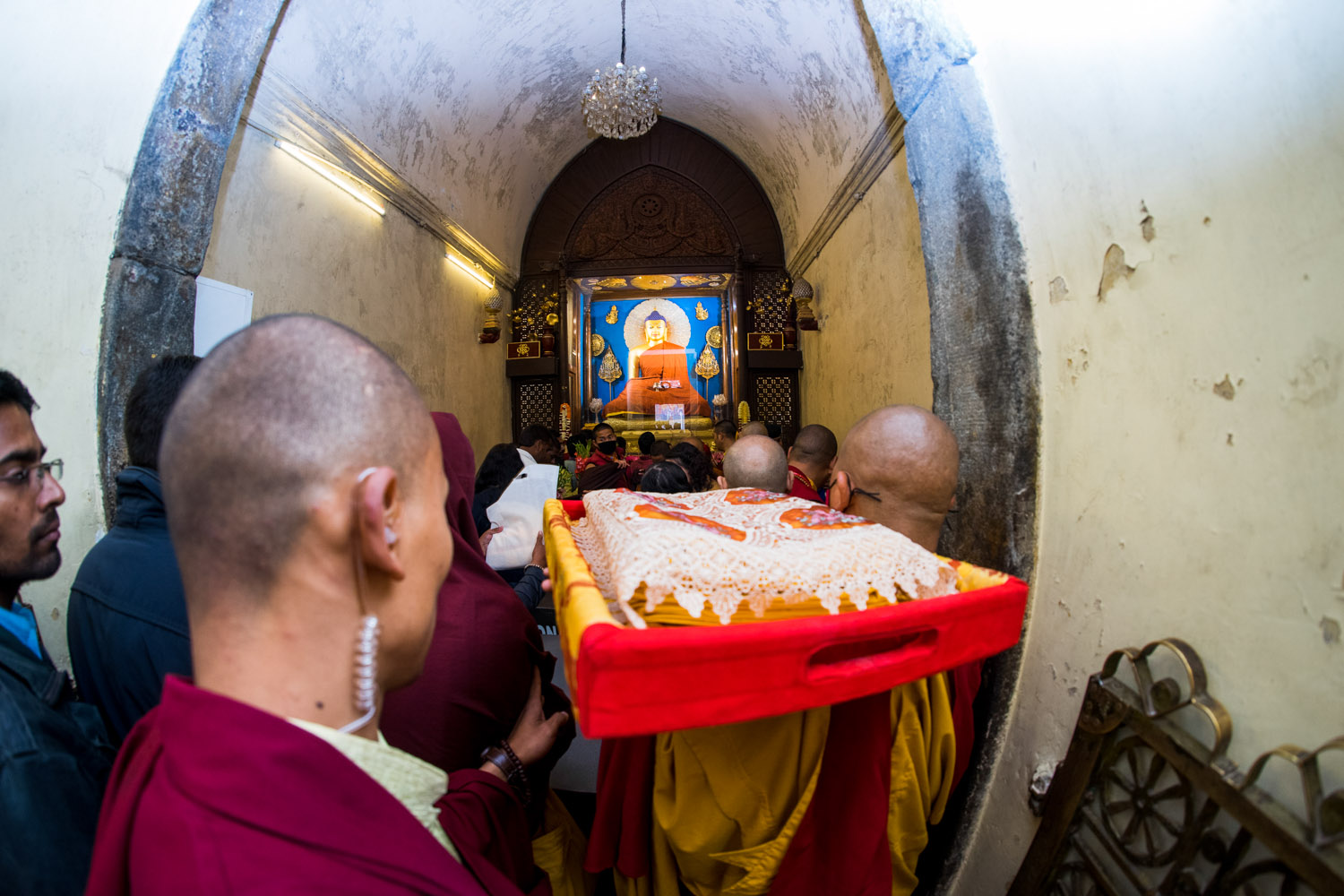 offering robes to the statue of buddha